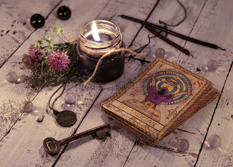 Black candle and old tarot cards on wooden planks royalty free stock photo