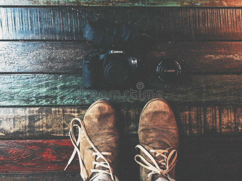 Black Canon Dslr Camera In Front Of Brown Shoes Free Public Domain Cc0 Image