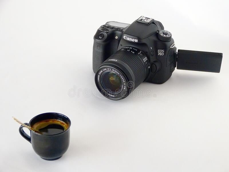 Black Canon Dslr Camera in Front of Coffee in Black Ceramic Teacup stock photos