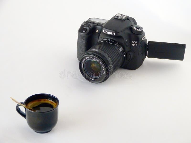 Black Canon Dslr Camera In Front Of Coffee In Black Ceramic Teacup Free Public Domain Cc0 Image