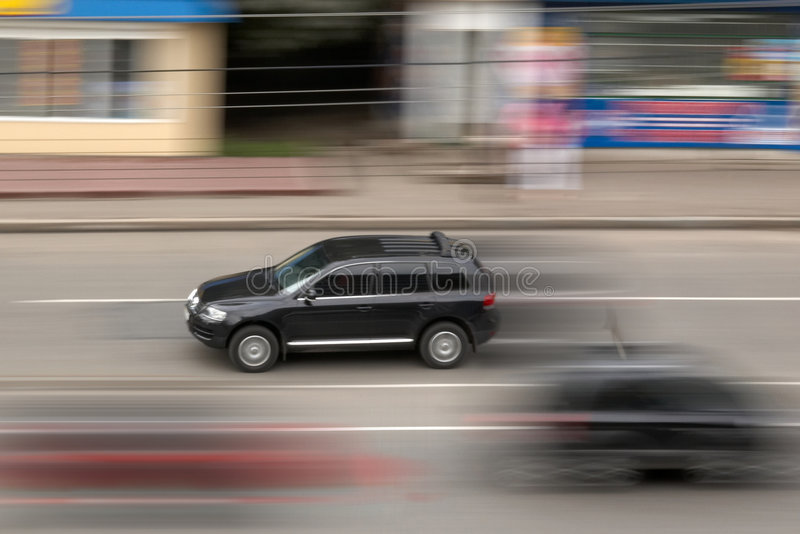 Black car. The image of the black car in movement stock image
