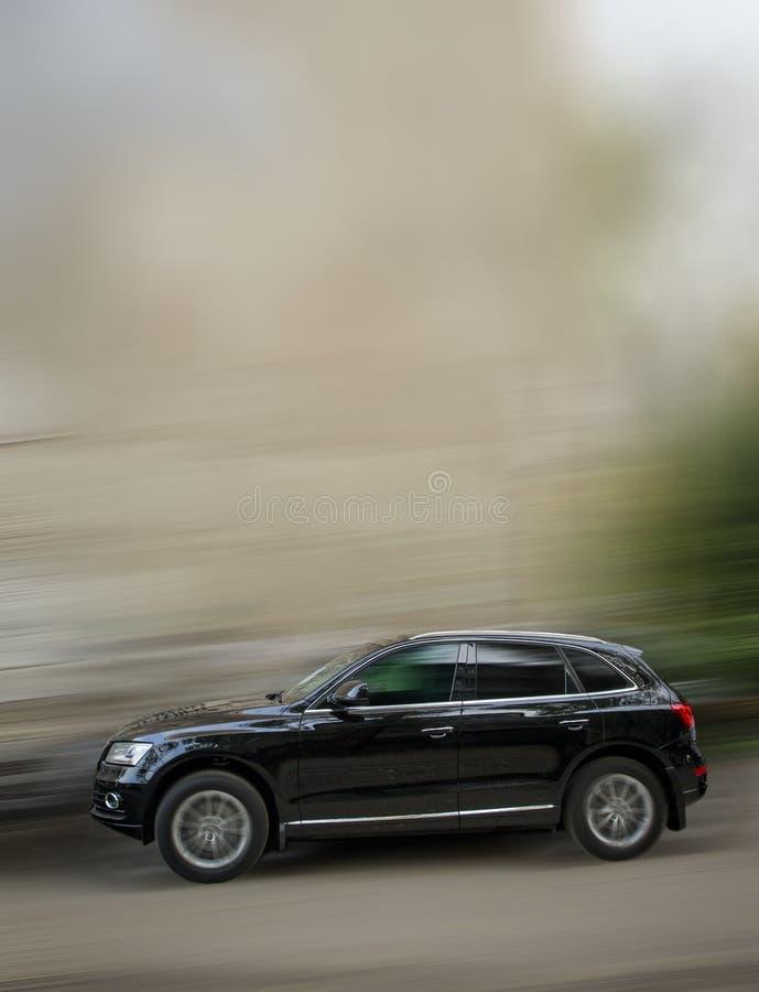 Black car Audi Q5. Black car Audi Q5 on a blurred background in motion royalty free stock photos