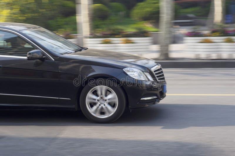 A black car driving. royalty free stock photo