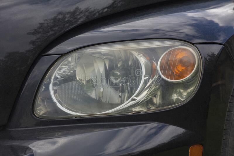 Black car with headlights off stock image