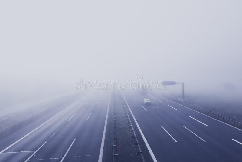 Black Car on Hi-way With Fog royalty free stock photos