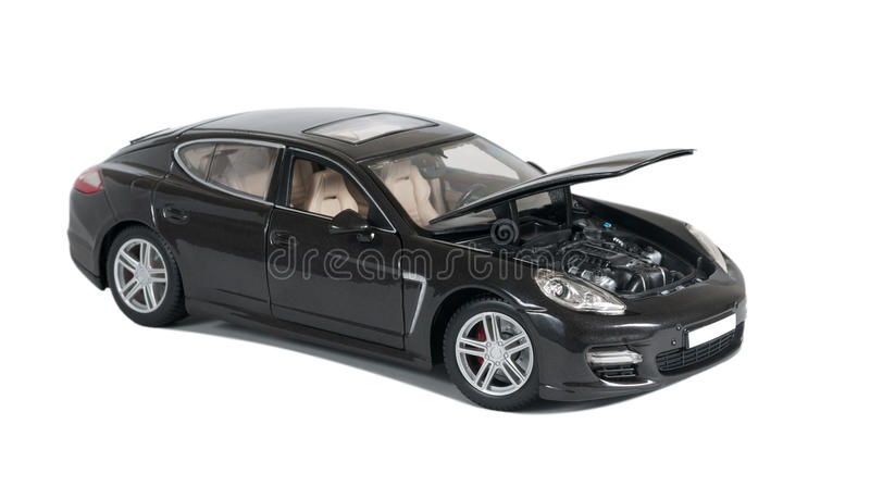 Black car with open hood. Collectible toy car with open hood on a white background royalty free stock images