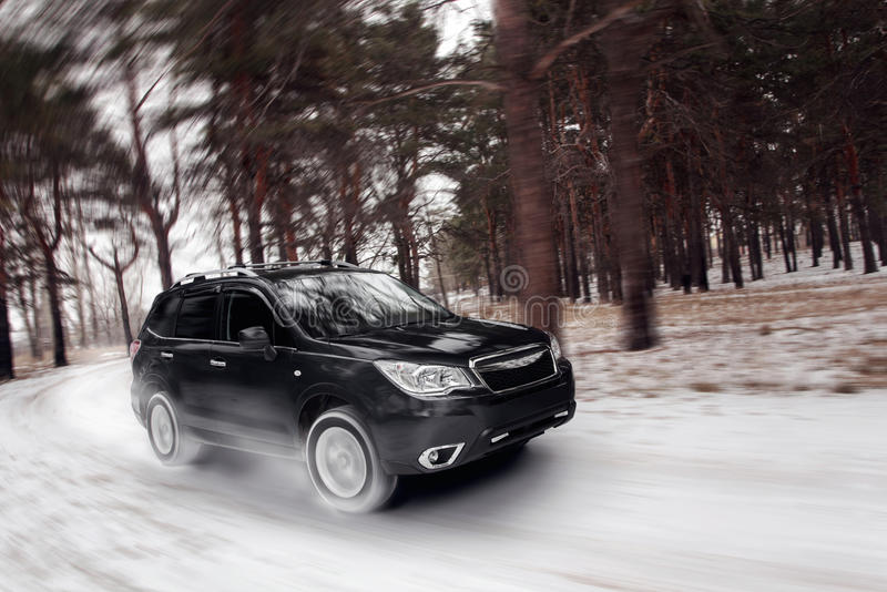 Black car speed drive on off road at winter daytime stock images