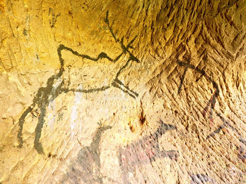 Black carbon paint of deer on sandstone wall, prehistorical picture. Abstract art in cave. Black carbon paint of deer on sandstone wall, prehistorical picture stock photography
