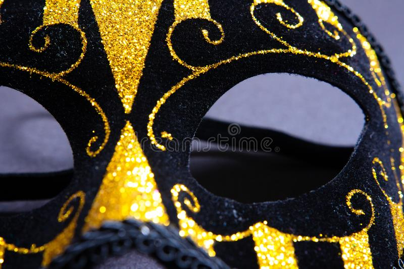 Black carnival mask. With gold rhinestones royalty free stock images