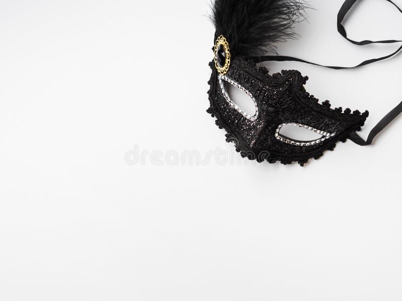 Black carnival mask on white background royalty free stock photography