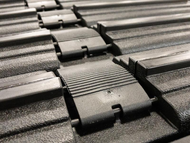 Black cases and buckles. A close up on the buckles on black cases in a row stock photography