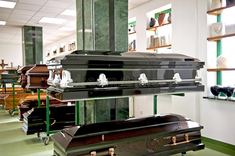Black casket. The black casket in a casket store royalty free stock photography