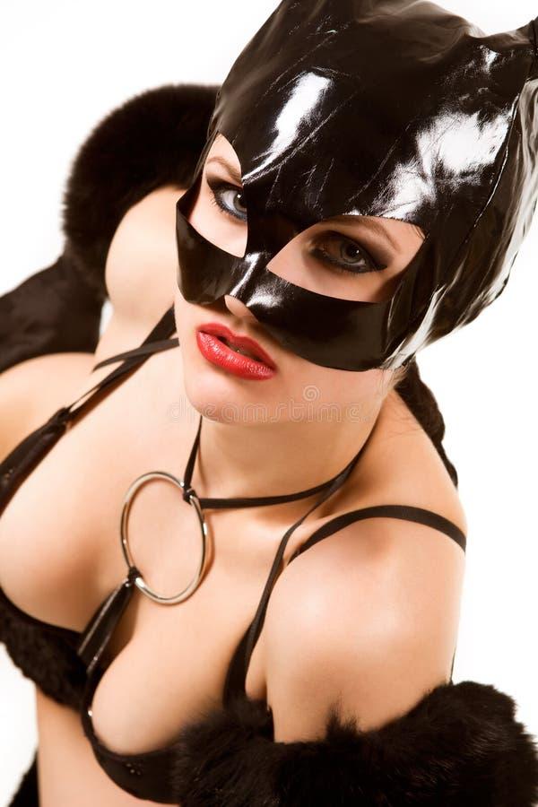 Black cat. Hot beautiful model in latex cat costume royalty free stock images