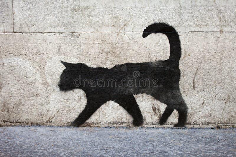 Black Cat Graffiti. Graffiti outline of a black cat in urban Paris stock photo