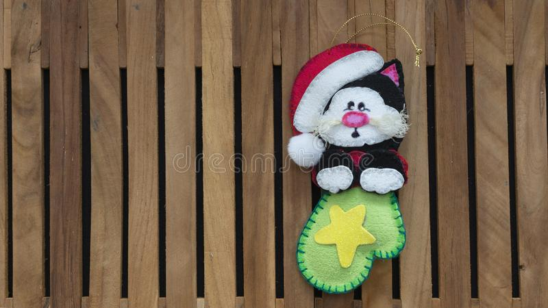 Black cat with santa claus hat inside a green boot made in foamy for christmas decoration royalty free stock photos