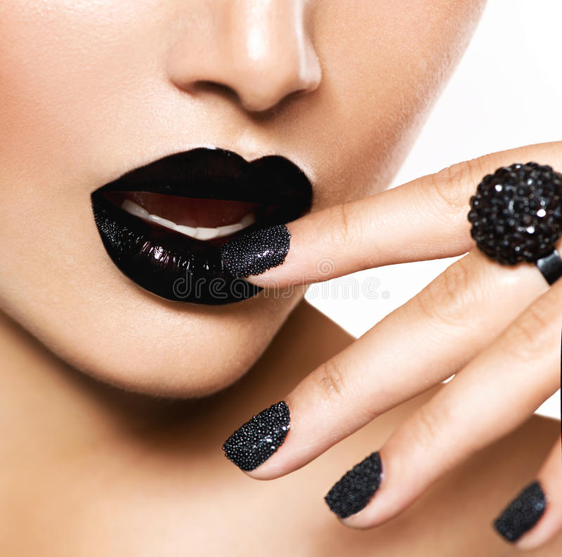 Black Caviar Manicure and Black Lips. Trendy Black Caviar Manicure and Black Lips. Fashion Makeup royalty free stock images