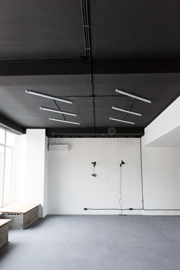 Black ceiling with LED lights in the office. Loft interior design stock images