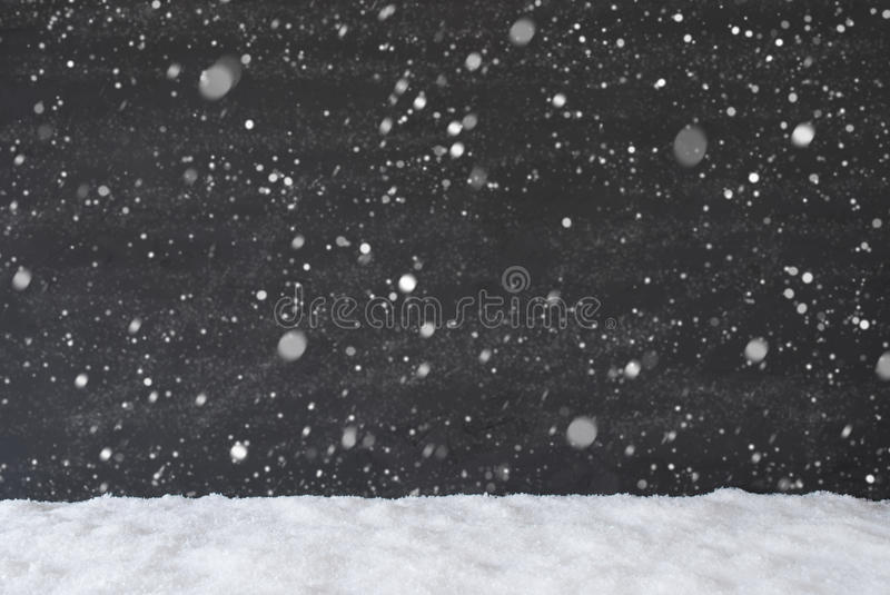 Black Cement Wall With Snow As Background Or Texture, Snowflakes royalty free stock image