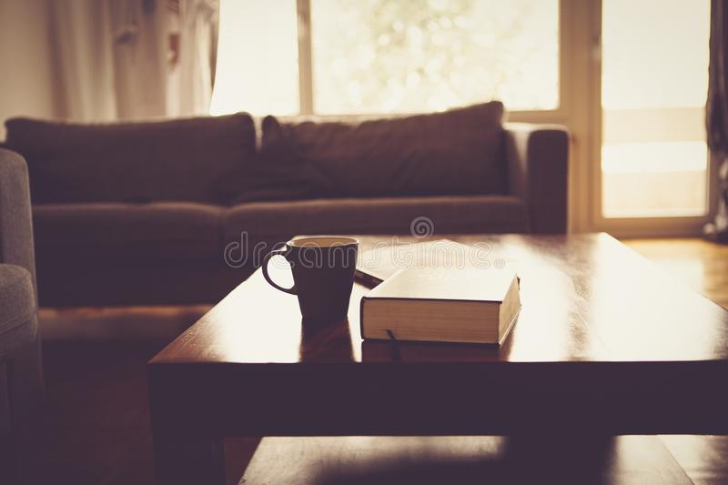 Black Ceramic Mug Beside Black Hardbound Book On Brown Wooden Coffee Table Free Public Domain Cc0 Image