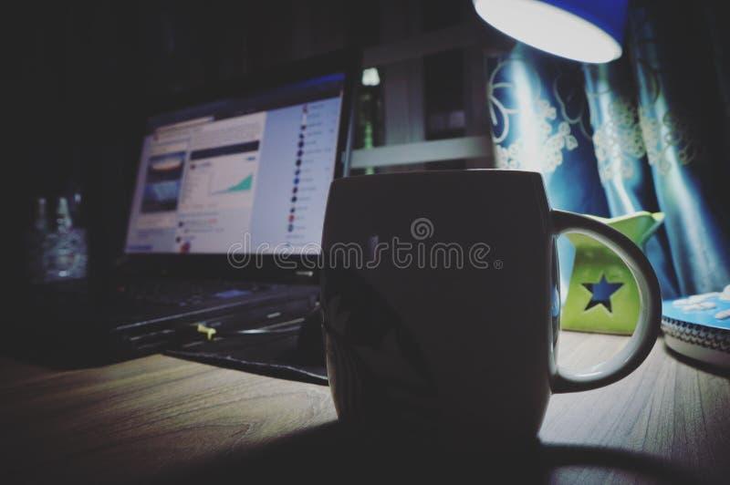 Black Ceramic Mug Near Black Laptop stock photo