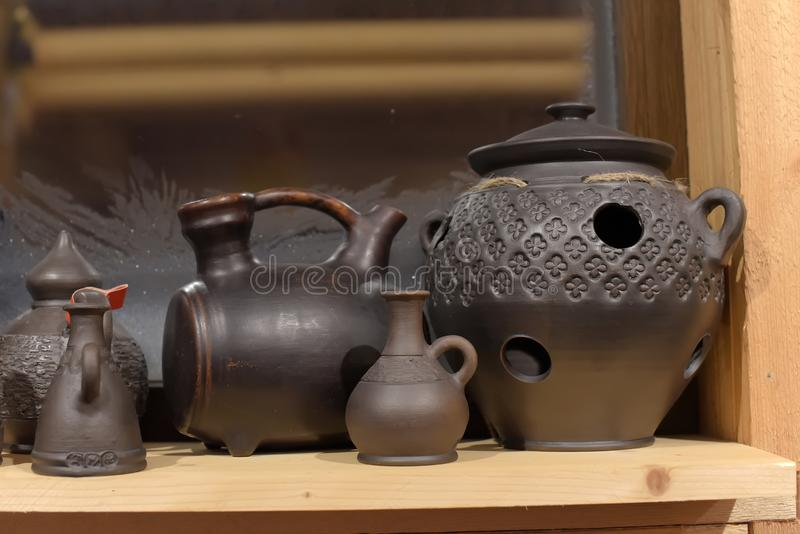 Black ceramics - one of the types of ceramics, burned by a special technology - in a wood-burning stove. Without oxygen stock photography