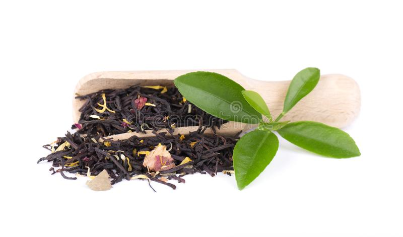 Black ceylon tea with rose petals, cornflowers and sunflower, isolated on white background. royalty free stock photography
