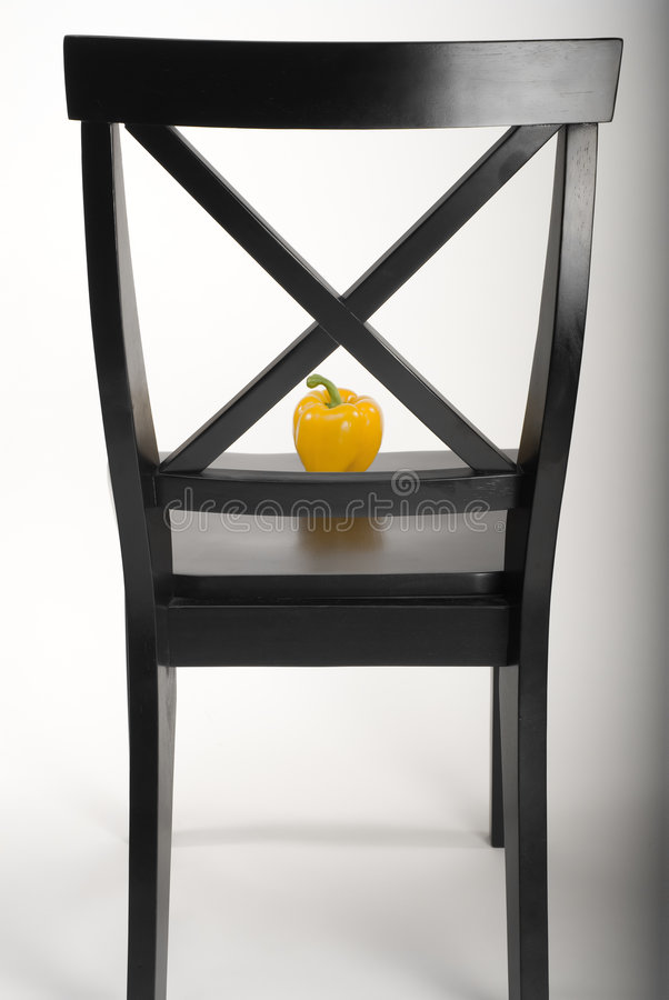 Black chair and pepper royalty free stock images