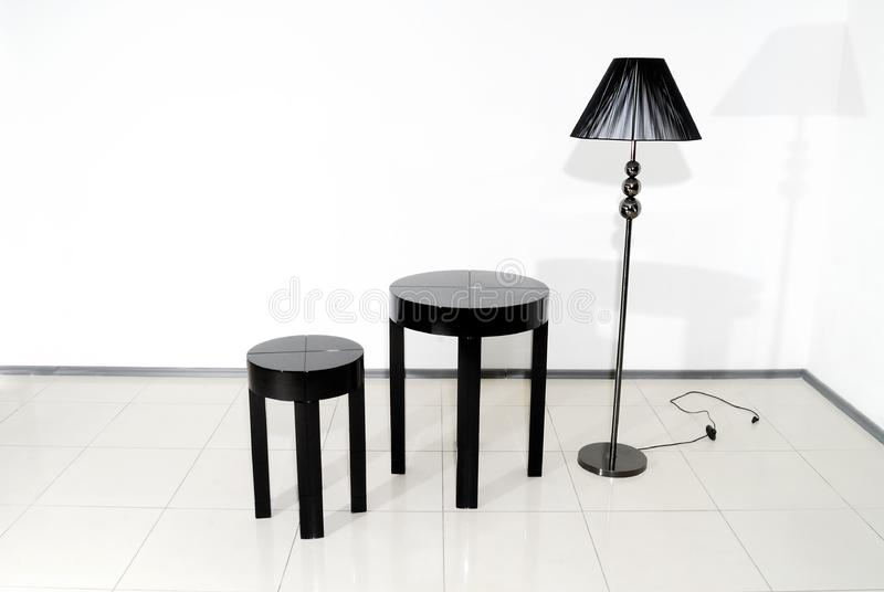 Black chair, table and floor lamp stock photos