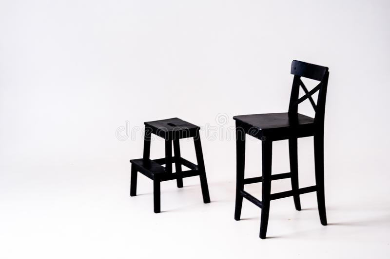 Black chair on white background, in white room. Black chair on a white background, in a white room or on stage or in the Studio royalty free stock images