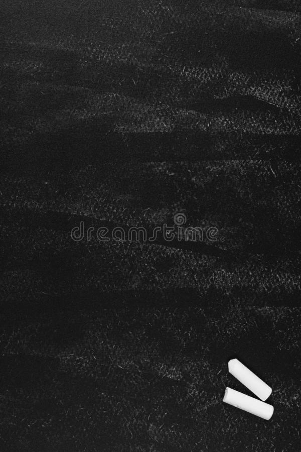 Black chalk board with white chalk background. Grunge empty blackboard or Chalkboard texture vertical stock photos
