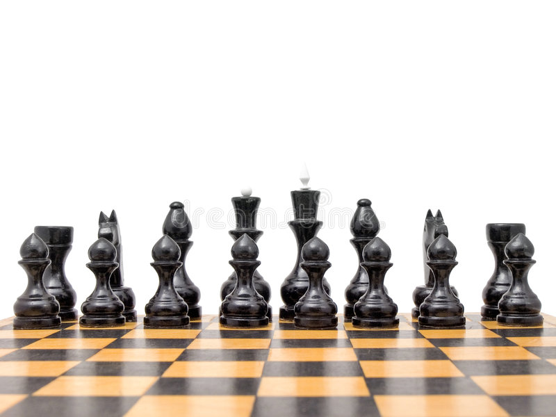 Black chess pieces on board. Close up of black chess pieces on board, isolated on white background royalty free stock photos