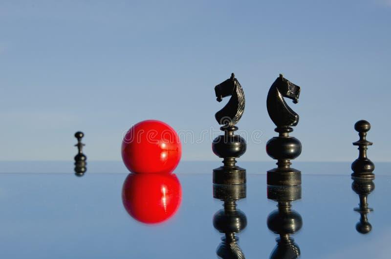 Black chessmans on mirror royalty free stock photo