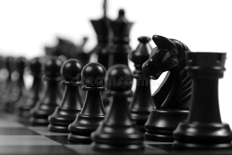 Black chessmen stock photo