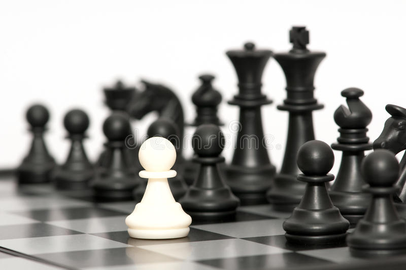 Black chessmen. On a chessboard royalty free stock image