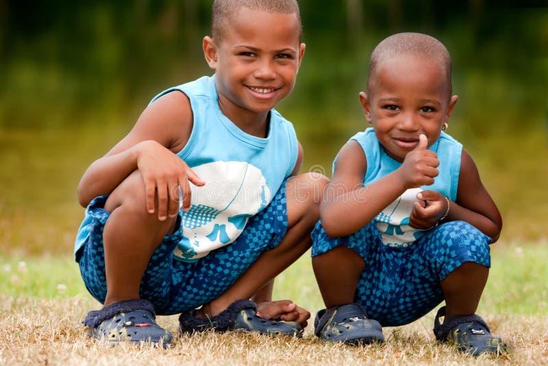 Black children say ok stock photography