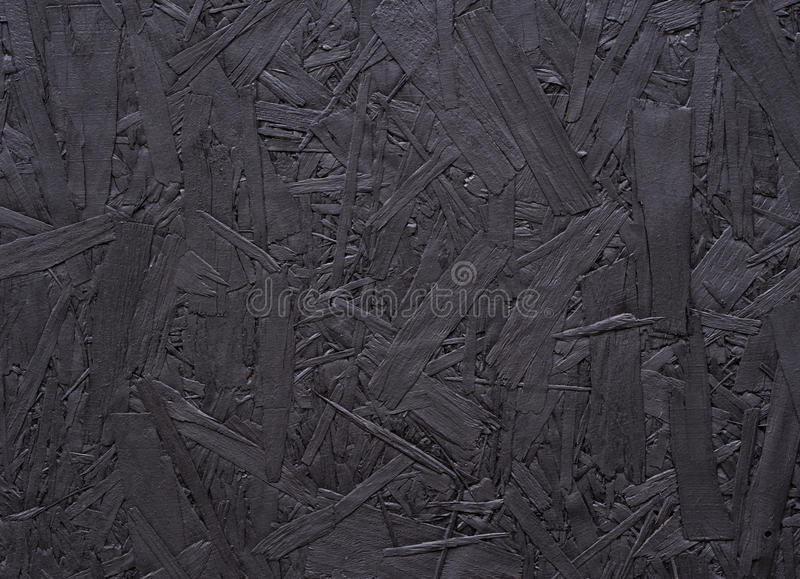 Black Chipboard Abstract Background. Section of chipboard painted black - abstract background royalty free stock photos