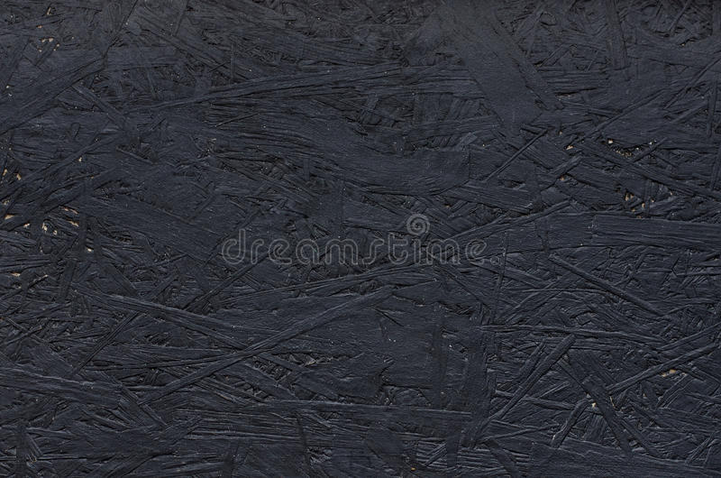 Black chipboard also called particleboard. Background texture. royalty free stock image