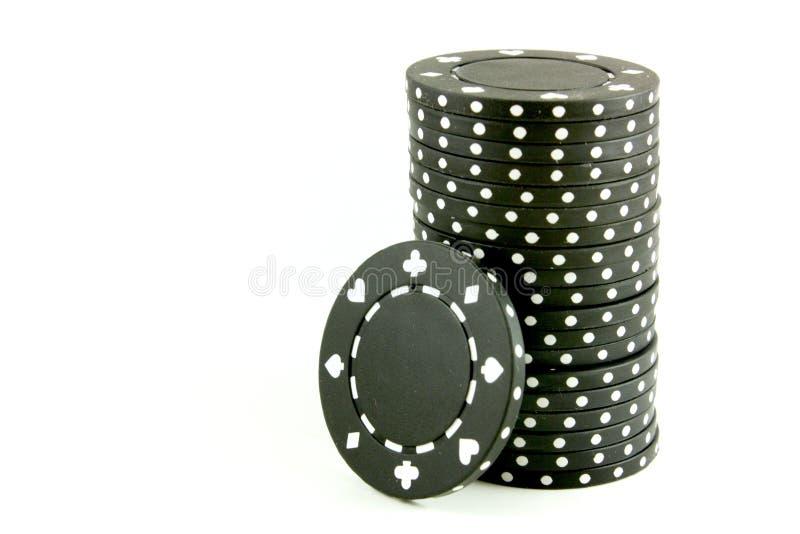 black chips poker arkivfoton