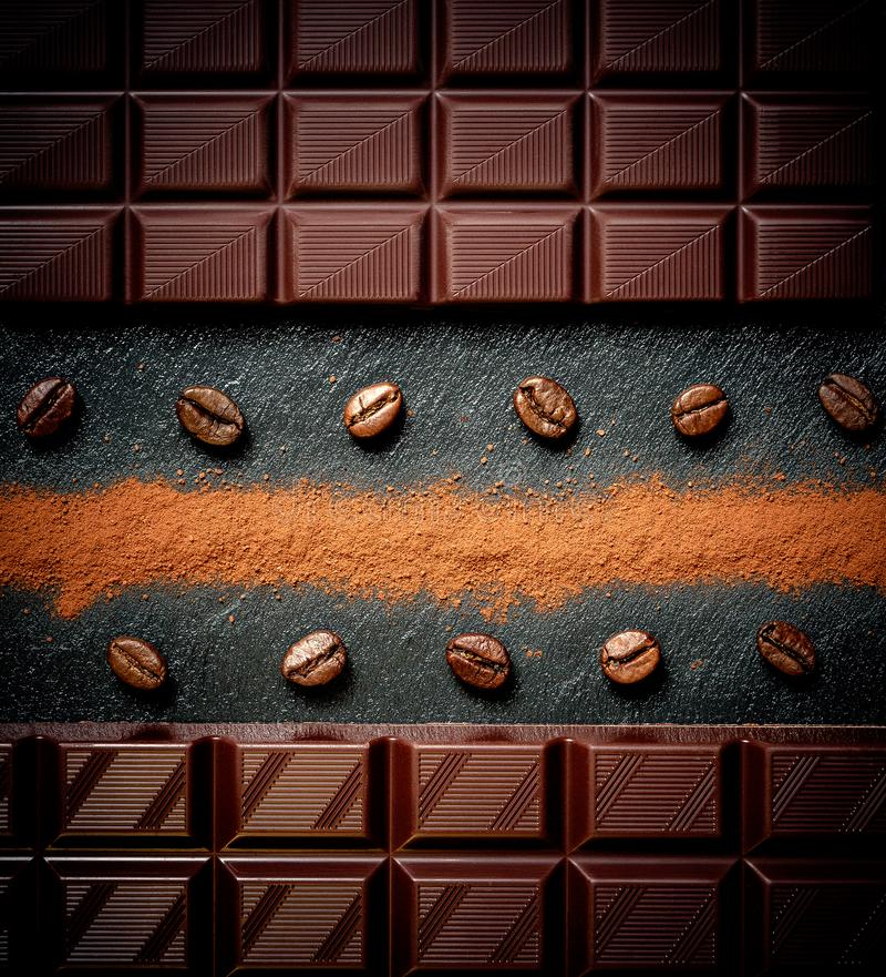 Black chocolate bar, coffee beans, cocoa powder on black royalty free stock photo