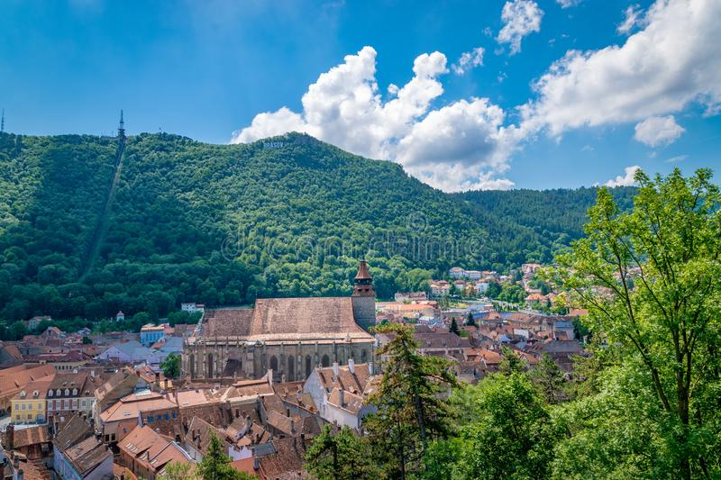Black Church with Brasov sign and Tampa mountain in the background stock image