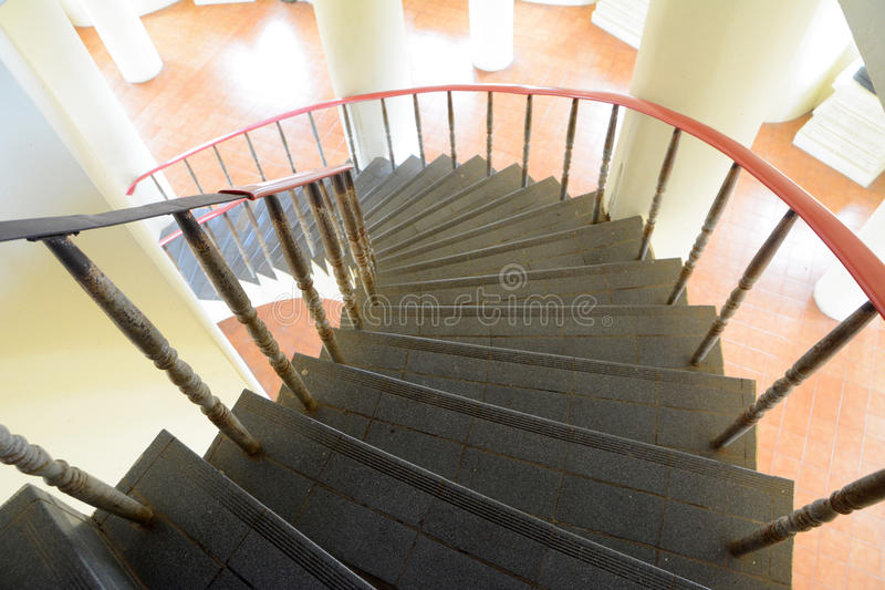 Black Circular staircase. With pole and floor background royalty free stock photography
