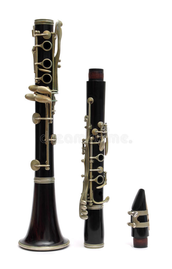 Black clarinet. Clarinet in three pieces over white stock images