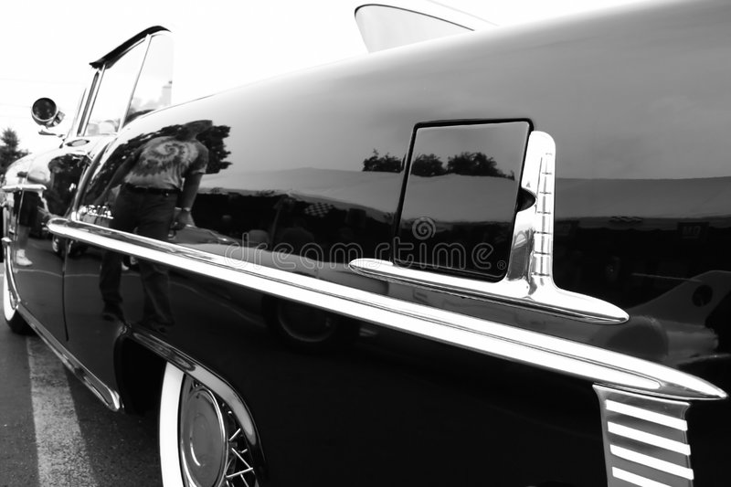 Black classic. Car side view from rear royalty free stock photography