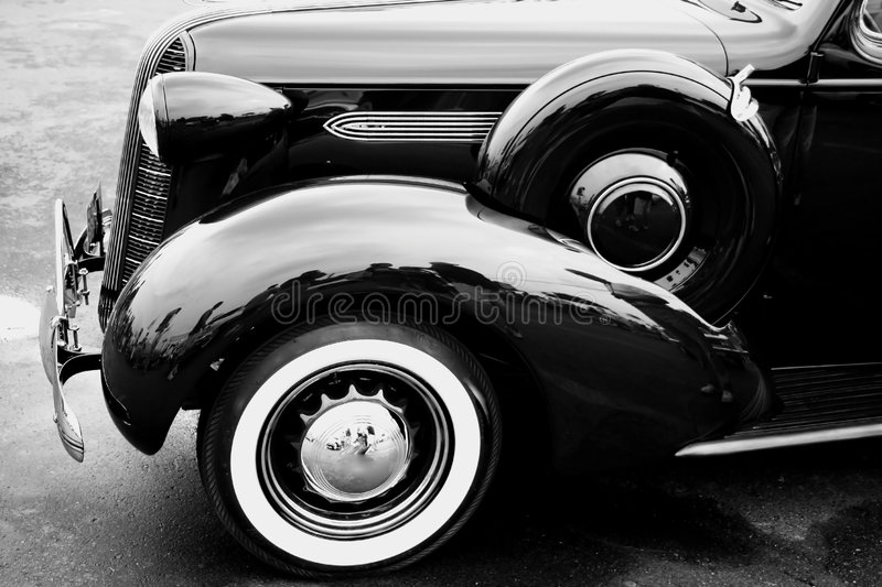 Black classic car. View from side stock image