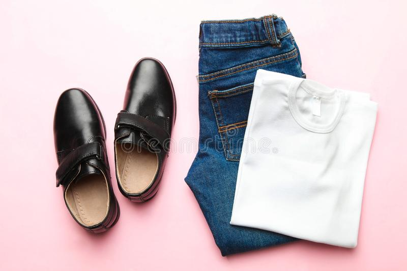 Black classic shoes and clothes. On pink background. Top view royalty free stock images
