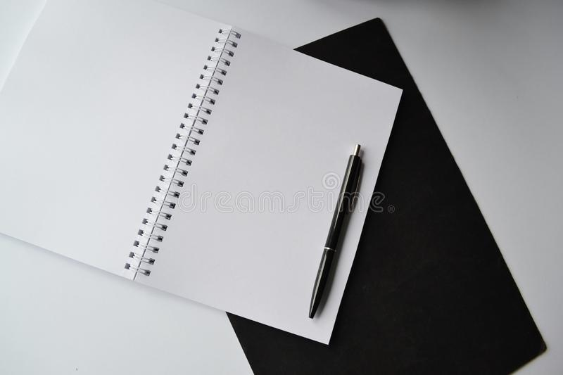 Black Click Pen on Spiral Notebook royalty free stock photo