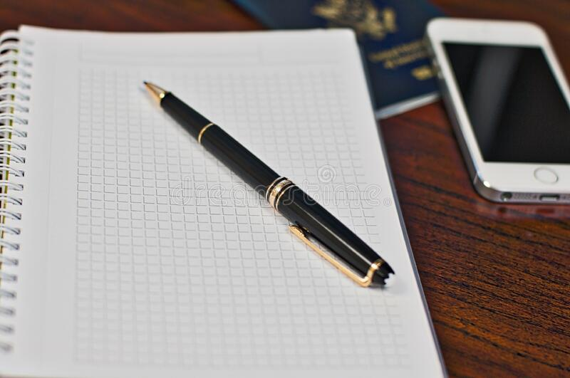 Black Click Pen on Spring Notebook stock image