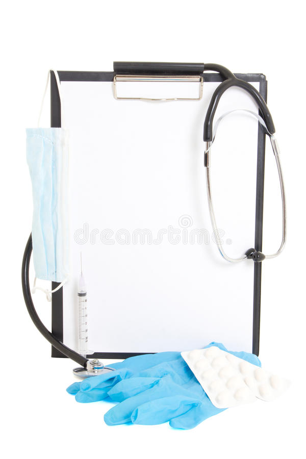 Black clipboard with blank paper sheet and medical supplies isolated on white. Background stock images