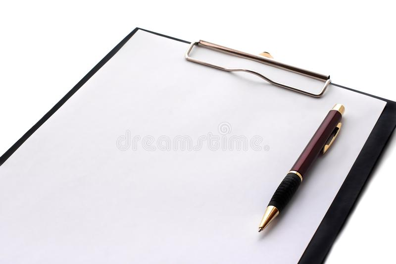 Black clipboard with blank sheet of paper and metal pen isolated on white background. Top view office accessories concepts.  stock photography