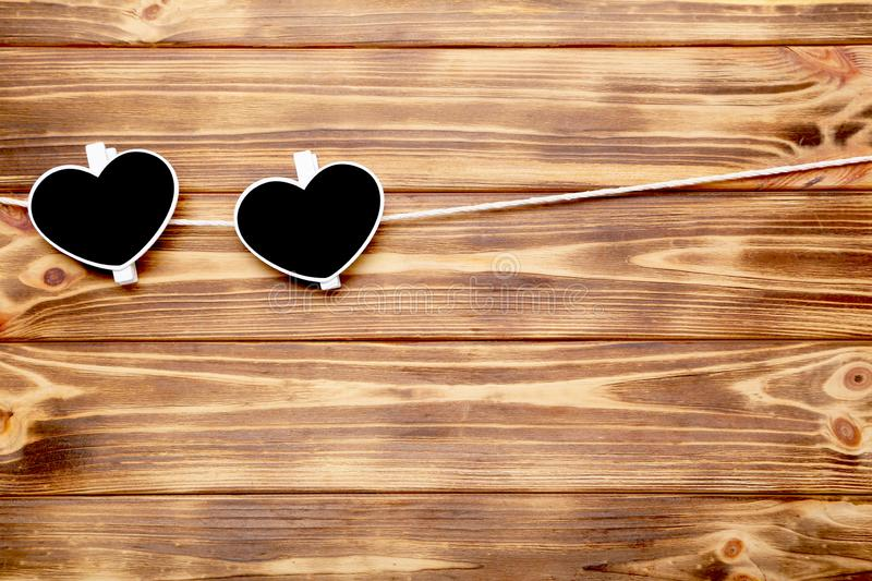 Clothespins in shape of heart stock image